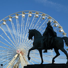 The statue with a wheel background by Svetlana Saenkova - Buildings & Architecture Other Exteriors ( horse, blue sky, ferris wheel, horseman, silhouette, statue, autumn, rider,  )