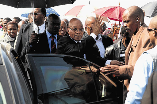 President Jacob Zuma leaves Lonmin's Marikana informal settlement after addressing thousands of angry workers, almost a week after 34 of their striking colleagues were shot dead by police Picture: MOELETSI MABE