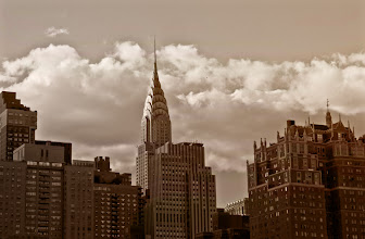 """Photo: """"Juxtaposition...""""  This is a favorite view of the Chrysler Building. In truth, the Chrysler Building is my favorite skyscraper in New York City. I have always loved the art-deco architecture of it's spire and how its needle pokes out above the other skyscrapers that populate the New York City skyline in midtown Manhattan.  This particular view is looking west towards Manhattan and sitting in the foreground are the skyscrapers of Tudor City: neo-gothic historic buildings that lay their claim to fame for being part of the first residential skyscraper complex in the entire world.    New York Photography: The Chrysler Building and Tudor City skyline.    You can view this post along with information about where to purchase prints of this image at my site here:  http://nythroughthelens.com/post/36813904311/the-chrysler-building-and-new-york-city-skyline  -  Tags: #photography  #newyorkcity  #newyorkcityphotography  #newyorkcityskyline  #nyc  #manhattan  #chryslerbuilding  #architecture  #city  #cityscape  #cityphotography  #urbanphotography  #skyscrapers  #nycskyscraper  #urbanlandscape  #urban  #manhattanskyline  #nycskyline"""