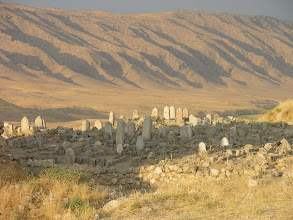 Photo: Yellow mountain ranges over a cemetery, Hasankeyf
