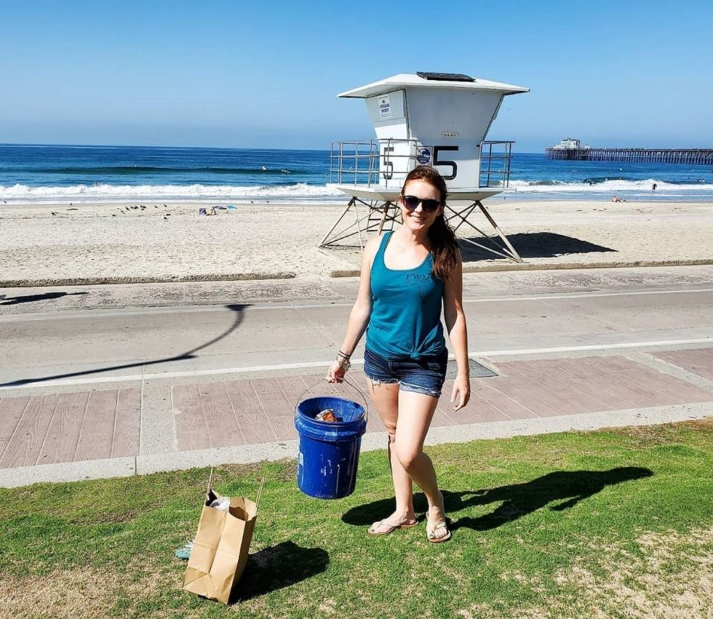 Rachel Walsh picking up plastic and trash at Oceanside, CA.