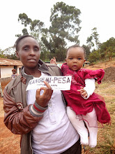 Photo: A mother eager to use Kangemi-Pesa