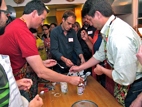 Photo: class members take turns tasting various brands of coconut milk