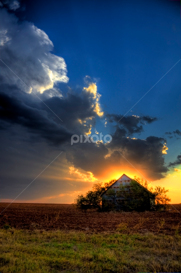 Old Shack Sunset by Glenn Patterson - Landscapes Sunsets & Sunrises ( clouds, field, orange, sky, red, blue, grass, sunset, shack, brown, yellow )