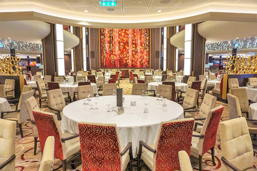 symphony-of-seas-main-dining-room.jpg - A shot of the three-deck main dining room on Symphony of the Seas taken from deck 3, the lowest deck.