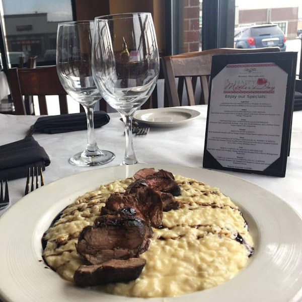 That is grilled Filet over a parmesan risotto with drizzled aged balsamic . Gluten Free!