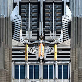 Art Deco Sculpture Detail on Urban Building  by Kevin Lucas - Buildings & Architecture Architectural Detail ( full frame, urban, sculpture, metal, wings, power, architecture, art deco, city, stainless steel )
