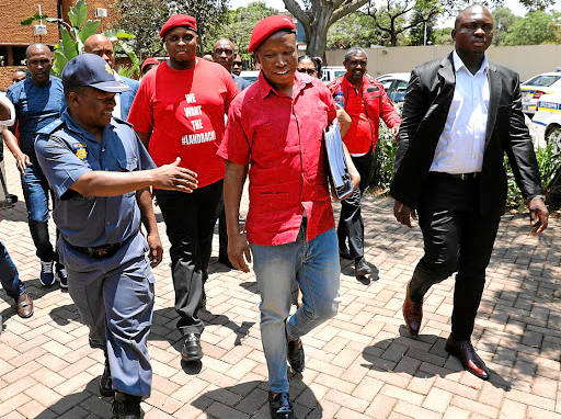 EFF leaders Julius Malema and Floyd Shivambu arrive at the same police station Pravin Gordhan used to open charges against the party leader on Monday, to open his own criminal case against the Public Enterprises minister. Picture: Sunday Times/Alon Skuy