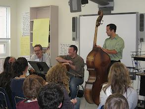 Photo: Wayne Fugate (mandolin), Aaron Lieberman (guitar), David Gandin (bass)