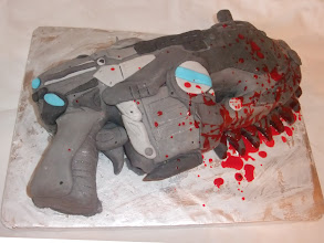"""Photo: A """"Gears of War"""" Lancer cake, complete with edible blood"""