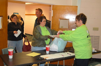 Photo: Pam checks everyone in and gives them their T-Shirts.
