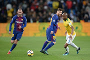 FC Barcelona superstar Lionel Messi and Tebogo Langerman of Mamelodi Sundowns during the International Club Friendly match between Mamelodi Sundowns and Barcelona FC at FNB Stadium on May 16, 2018 in Johannesburg, South Africa.