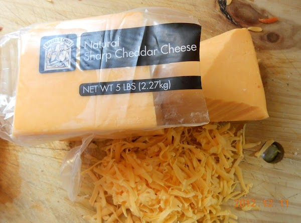 Grate cheese.