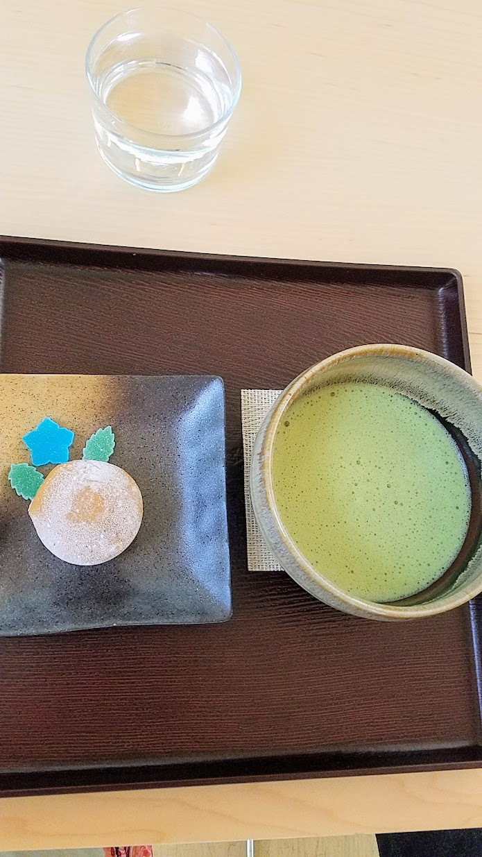 Visiting the Portland Japanese Garden Umami Cafe offering Japanese teas and snacks, Matcha with Mochi Ice Cream Set with a bowl of hand whisked matcha paired with premium chocolate ice cream wrapped in sweet rice dough