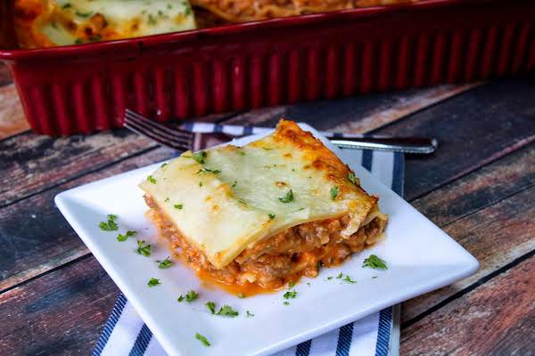 A Slice Of Lasagna On A Plate.