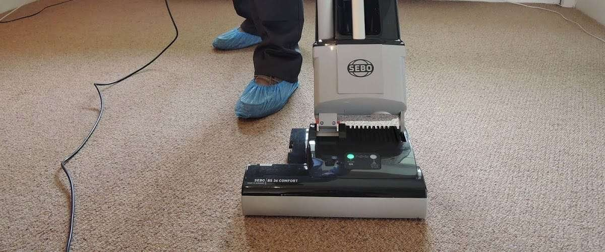 Carpet being vacuumed
