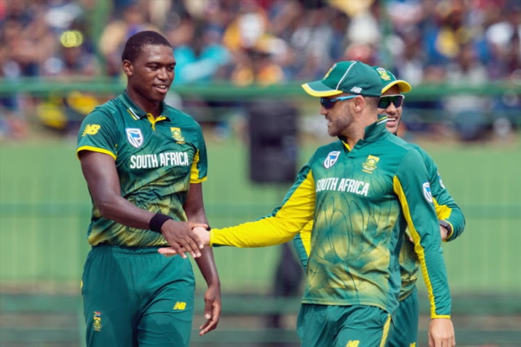 Lungi Ngidi of South Africa celebrates the wicket of Upul Tharanga of Sri Lanka (not in picture) along with Captain Faf du Plessis during the 3rd ODI between Sri Lanka and South Africa at Pallekele International Cricket Stadium on August 05, 2018 in Pallekele, Sri Lanka.
