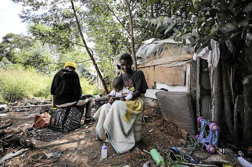Florence Chauke and her baby at home near Edenvale Hospital, east of Johannesburg. The area has been occupied by Alexandra residents