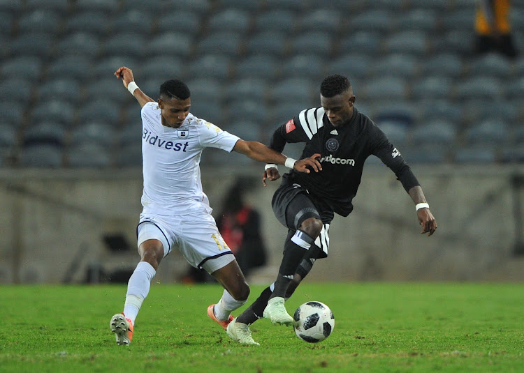 Vincent Pule of Bidvest Wits challenges Innocent Maela of Orlando Pirates. The two will be teammates for the 2017/18 season after Pirates announced Pule as one of their nine new players.