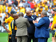 Bobby Motaung agitated in what looks to be a heated discussion between him and a match officia as the Kaizer Chiefs coaching and communications staff tries to calm him down during a Soweto derby match against arch rivals Orlando Pirates at FNB Stadium on February 29 2020.