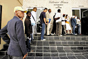 Unemployed people queue for UIF payments outside the department of labour offices in Port Elizabeth. Picture: FILE/JAMES OATWAY