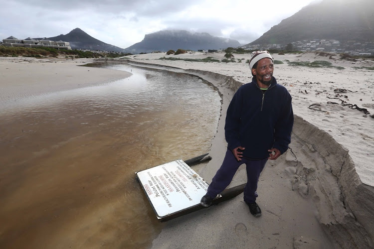 Gardener Isaac Crowster says the Disa River in Hout Bay is stagnant and polluted.