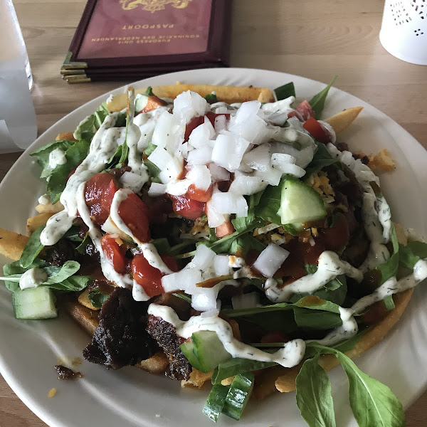 100% gluten free!  French fries with shawarma, cucumber, arugula, onions, cheese....very large portion. Shareable.