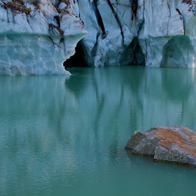 Ice Caves at Edith Cavell by Dan Warkentin - Landscapes Waterscapes ( water, clouds, ice cave, mountain, tree, rock )