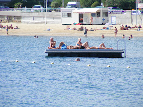 Photo: In the beach waters is this small floating dock, which would be equally at home at many US beaches.