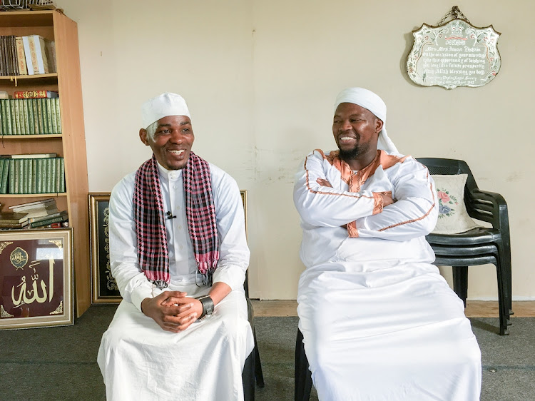 Xolani Donyeli and Imam Nazeem Ntintili sit in the Harare Masjied in Khayelitsha. Donyeli used to drink and play pool in the very same building before it was converted into a Masjied by Ntintili.