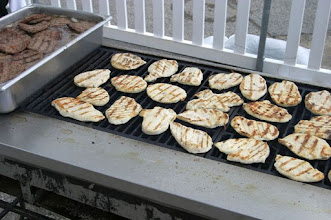 Photo: Grilling chicken and Hamburgers on large outdoor bar-b-cue
