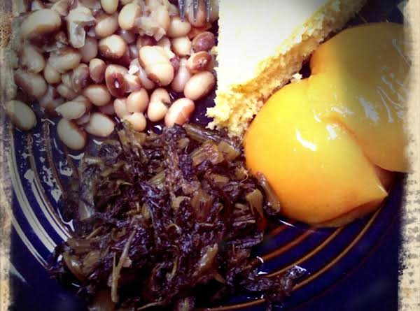 Yellow Eyed Peas, Mixed Greens, Cornbread And Pickled Peaches.