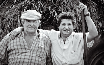 Photo: Galician Farmers posing for a quick portrait in front of their harvest crop