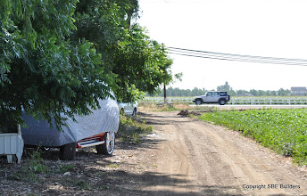 Photo: The SUV under the car cover belongs to the farm workers. Maybe it's time for me to change my occupation.