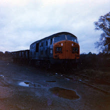 Photo: The engine couples to the trucks in the siding (Oct 1970)