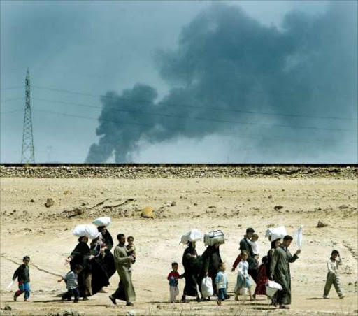 IN LIMBO: Palestinian exiles from Iraq are stranded in a camp. Pic. Dan Chung. 28/03/03. © AFP.