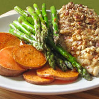 Almond-Crusted Chicken With Sweet Potatoes and Asparagus.
