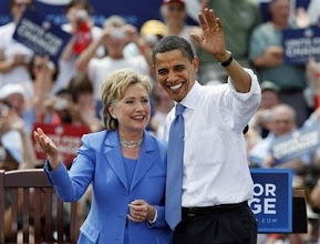 """Photo: Democratic presidential candidate Sen. Barack Obama, D-Ill., takes the stage with Sen. Hillary Rodham Clinton, D-N.Y., at a campaign event in Unity, N.H., Friday, June 27, 2008, their first joint public appearance since the divisive Democratic primary race ended.  """"Well, Unity is not only a beautiful place as we can see, it's a wonderful feeling isn't it? And I know when we start here in this field in unity, we'll end on the steps of the Capitol when Barack Obama takes the oath of office as our next president,"""" said Clinton. (AP Photo/Elise Amendola)"""