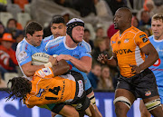 Divan Rossouw and Hendre Stassen of the Blue Bulls with Rabz Maxwane (No.14) and Oupa Mohoje (R) of Toyota Cheetahs during the Currie Cup game at Toyota Stadium in Bloemfontein on August 17 2018.