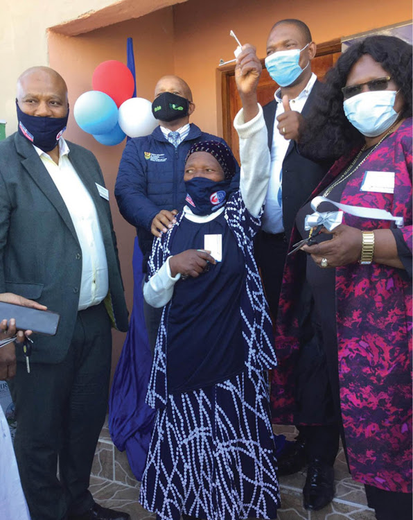 Jubilation! As Nomciciyelo Makabane holds the keys to her new home.