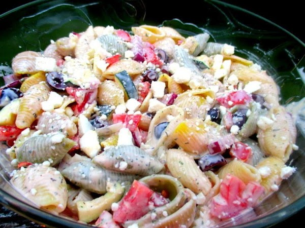 Pour prepared dressing over pasta and toss to coat. Refrigerate until ready to serve....