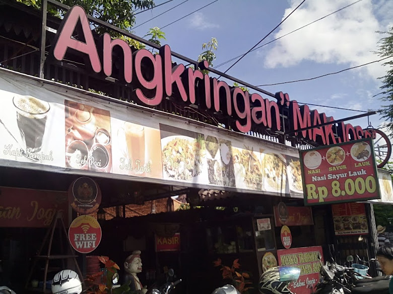 The entrance of Angkringan Mak Joss with Semar statue