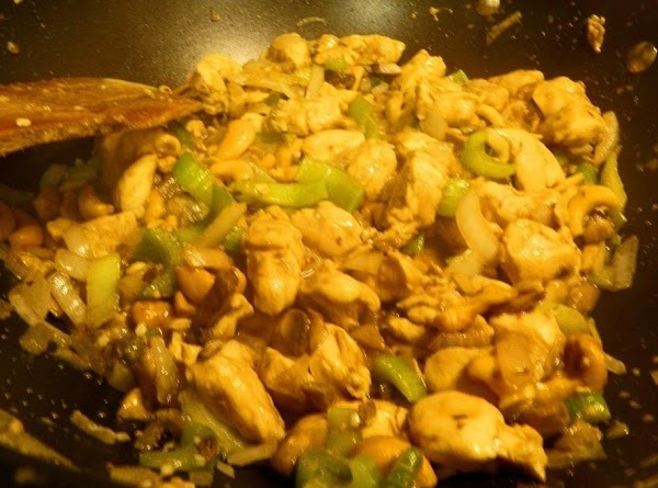 Heat the oil in a wok or large skillet over medium-high heat. Add the...