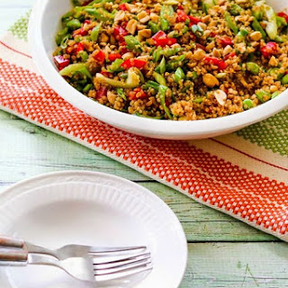 Asian Quinoa Salad with Snap Peas, Red Bell Pepper, Celery, and Peanuts.
