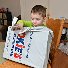 Photo: We placed our order on Thursday, January 31, and our package arrived Monday, February 4. LC couldn't wait to dig in and see his new clothes!