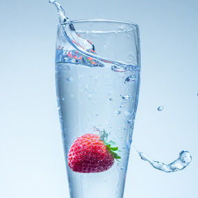 Strawberry Splash by Rajesh Loganathan - Food & Drink Fruits & Vegetables ( water, bubble, red, splash, glass, spill, motion, frozen, strawberry )
