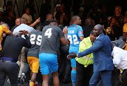 Angry Chiefs fans throwing objects to Steve Komphela, coach of Kaizer Chiefs and players leaving the field during the Absa Premiership 2017/18 match between Kaizer Chiefs and Chippa United at FNB Stadium, Johannesburg on 07 April 2018.