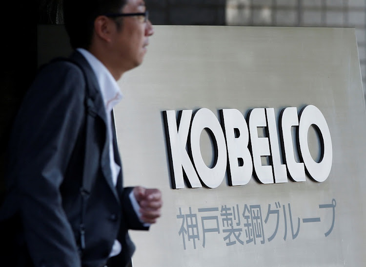 A man walks past the signboard of Kobe Steel at the group's Tokyo headquarters in Tokyo, Japan ON October 10, 2017.     Picture: REUTERS