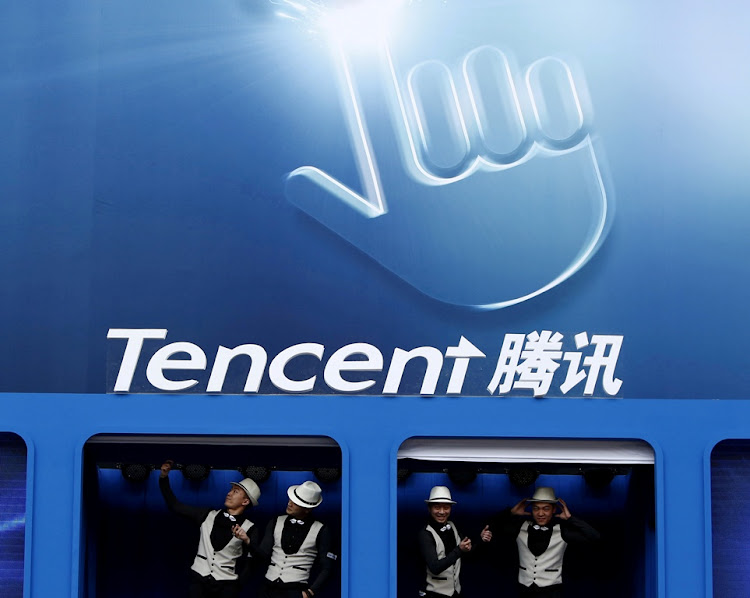 Dancers perform underneath a Tencent logo in Beijing, China.