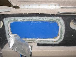 Photo: Passenger side window sanded for last layup.  Micro-Flox corner ready to sand.
